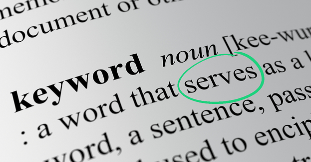 """The keyword section of the dictionary with the word """"keyword"""" and its definition highlighted with the word """"serve"""" circled in green"""