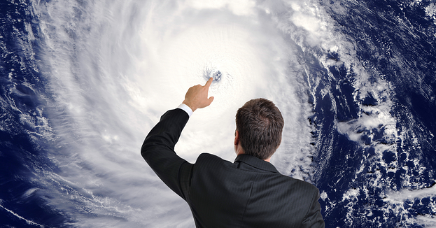 A meteorologist touches the satellite image of a hurricane eye