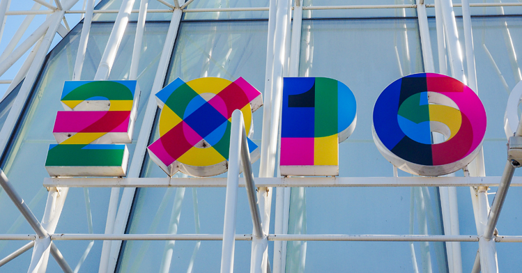 """Multicolored sign above the Milan Exposition Hall that read """"EXPO"""""""