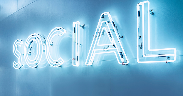 A blue neon sign of the word social on a light blue background