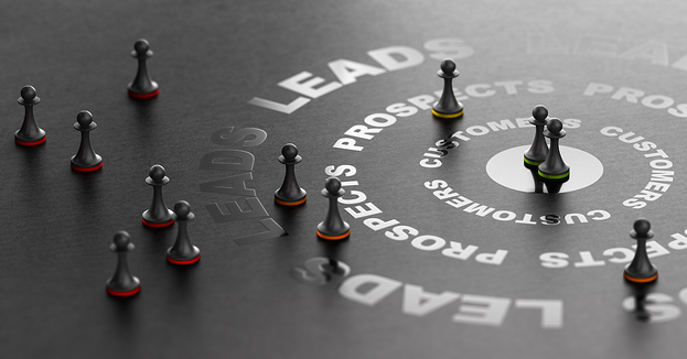 Game pieces scattered strategically around a black board with the word Leads printed in a circle to represent lead generation