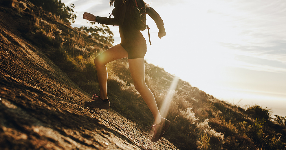 A person running uphill in nature